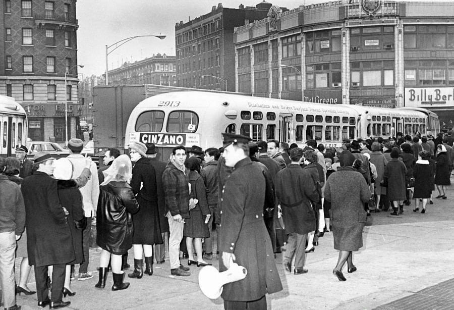 a-massive-line-of-commuters-by-bus-1966-barney-stein (2).jpg
